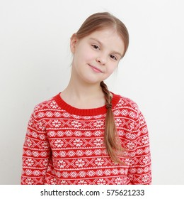 little girl wearing red sweater on Christmas holiday