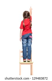 little girl wearing red t-shirt and pointing to  something up high on white background