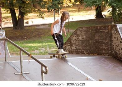 little girl wearing in sport wear. child with skateboard. hobby. sport. Lifestyle
