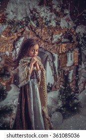 The little girl went in search of snowdrops in the cold winter night.Fashionable toning,creative computer colours