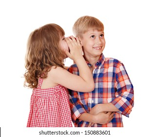 little girl whispers a secret to the boy