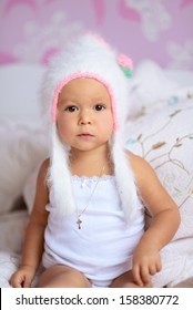 the little girl in a white hat