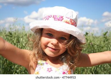 Little girl in white hat