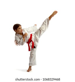 The little girl in a white kimono with a red belt competition causes a high kick