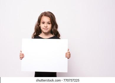 Little girl. White list. Light background.