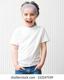 little girl in a white t shirt