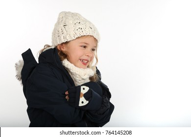 Little girl in winter clothes