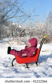 Little girl in the winter park