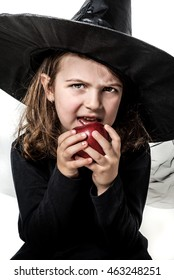 Little Girl in Witch Costume Holding Red Poisoned Apple
