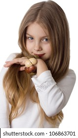little girl with a wooden bracelet poses for the camera
