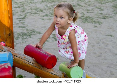 little girl wooden playground slide climbs sunset