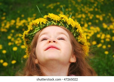 Little girl with wreath of dandelions
