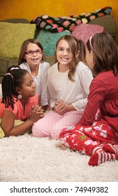 Little girl wrings hands with friends at a sleepover