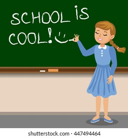 Little girl to write with chalk on the school blackboard. School is cool