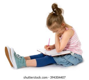 Little girl writing the story