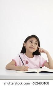 little girl writting doing homework