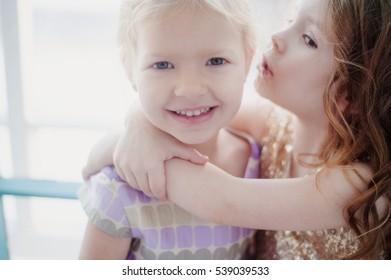 little girlfriend whispering in ear secrets