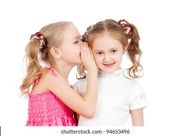 Little girlfriends sharing a secret isolated on a white background
