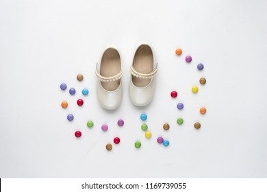 Little girlie baby shoes on marble background