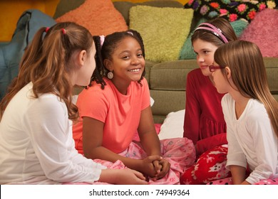 Little girls engrossed in an interesting conversation
