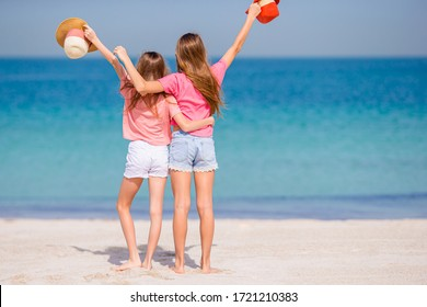 Little girls having fun at tropical beach during summer vacation
