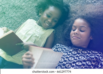 Little Girls Lay On The Floor Reading Book Sisterhood