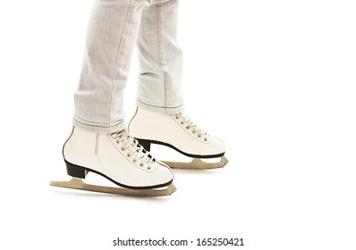 Little Girl's Legs in White Ice Skates.  Isolated On White Background