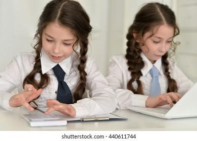 little girls making homework