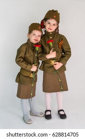 Little girls in military uniform at the May 9 celebration in Russia, Victory Day. Isolated on white background