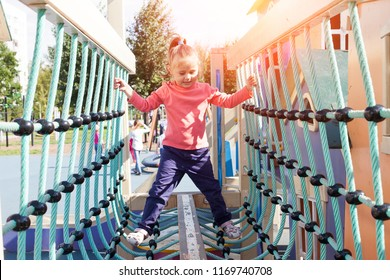 Little girls pass the obstacle course on the playground
