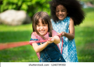 Little girls play fun game at summer camp. Children camp game recreation and summer fun activity.