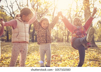 Little girls playing in park.