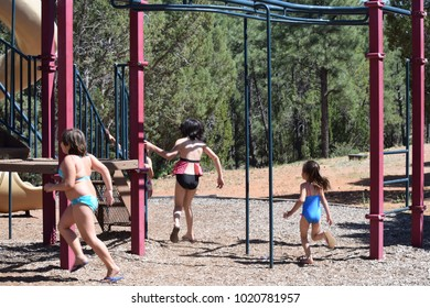 Little girls playing in the park playground