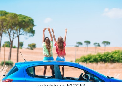 Little girls travel by the car on summer vacation in Italy