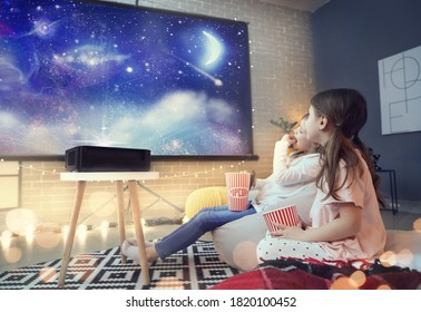 Little girls watching movie at home