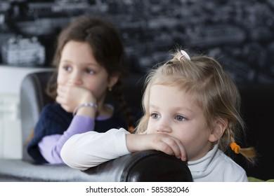 Little girls watching tv