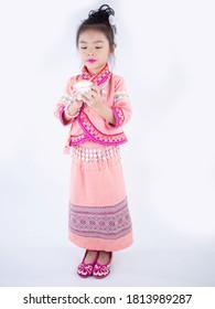 little girls wearing pink native dress on white background