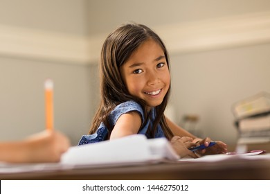 Little Girls Working On School Work