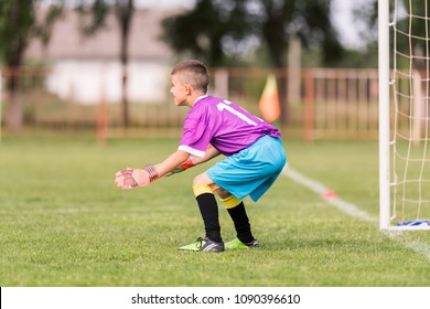 Little goalkeeper used hands for catches the ball in match game
