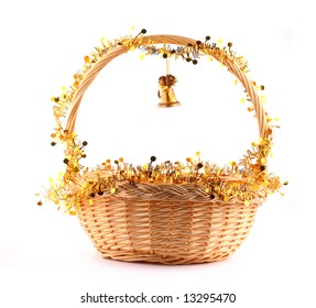 little golden bell attached to string to present basket with gold garland