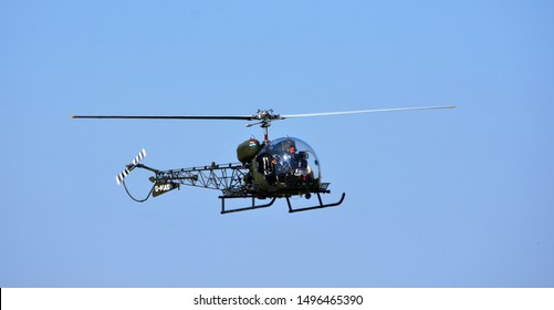 LITTLE  GRANSDEN,  CAMBRIDGESHIRE, ENGLAND - AUGUST 25, 2019:  Bell 47G-4A G - MASH  Helicopter in flight