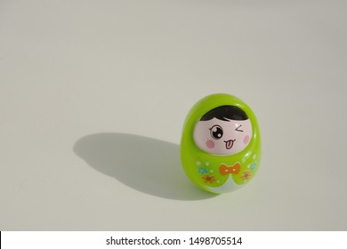 little green dolls tumbler with a smile
