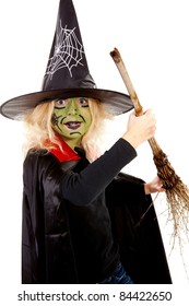 little green Halloween witch with broom over white background