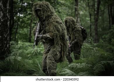 Little green men during patrol in forest