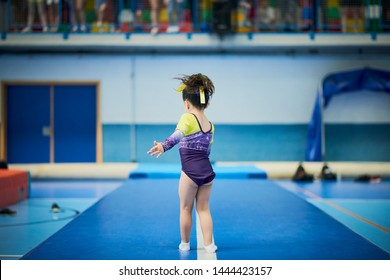 Little gymnast in a competition