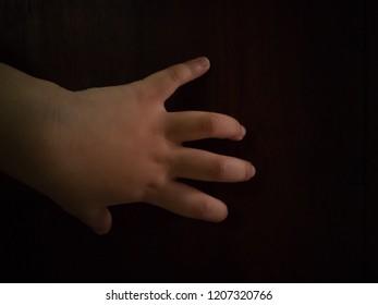 little hand in the dark