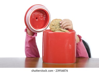 A little hand reaching into the cookie jar.