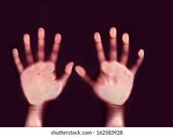 Little hands, an digital hybrid image originating from a scan.