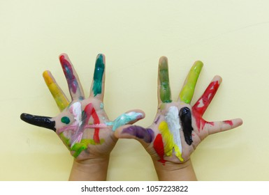 Little hands painted by watercolor colorful paints.