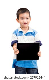 Little handsome Asian boy portrait holding tablet with smiling face isolated on white background